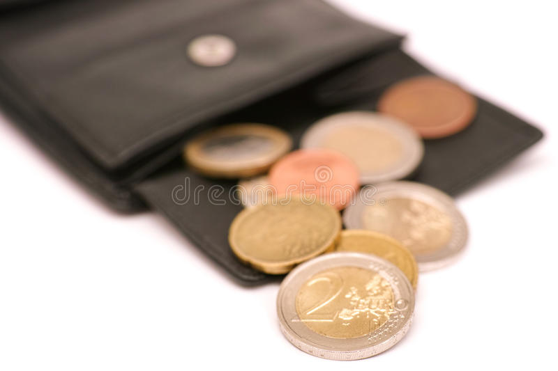 Euro wallet. Euro coins coming out of a purse for your financial, bonus, cashback, gifts and presents copy - note, that the money is real and used - very royalty free stock photography