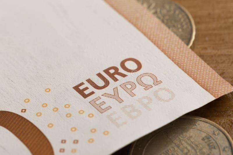 50 euroanmärkningar och mynt avbildar arkivfoton