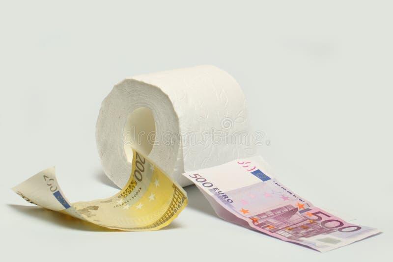 Eurobanknote und Toilettenpapier stockbilder