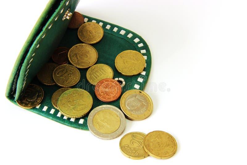 Eurocent och grön plånbok arkivfoto