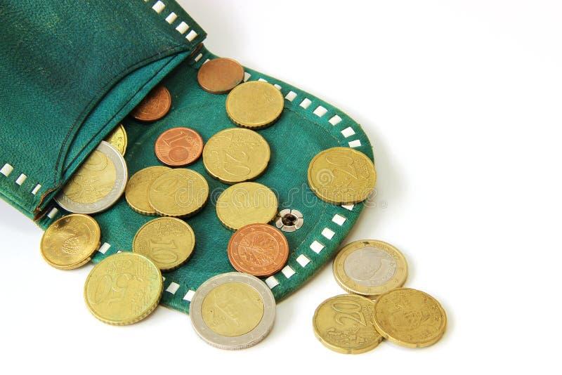 Eurocents und grüne Geldbörse stockbilder