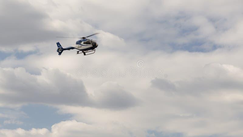 Eurocopter EC 120B Colibri YR-MDI. Helicopter flight demonstration at AeroNautic Show 2013 - Morii Lake, Bucharest royalty free stock image
