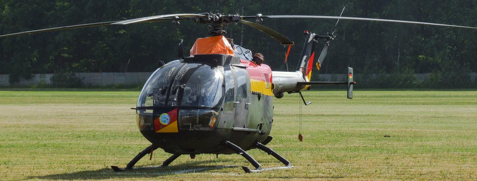Eurocopter MBB Bo-105 of german airforce on grass airfield. Eurocopter MBB Bo-105 of german air force on grass airfield in Goraszka. Dark gree and black stock images