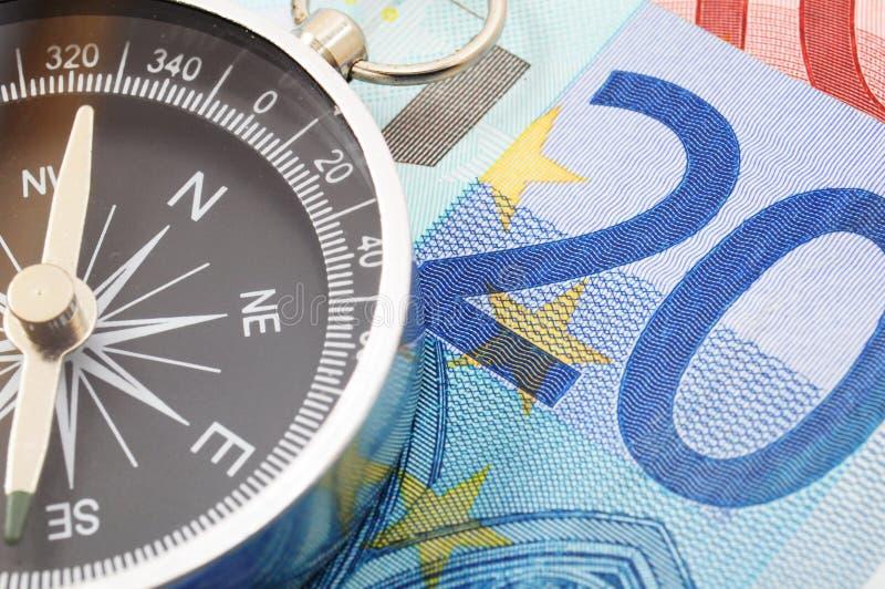 Eurogeld und Kompaß lizenzfreie stockbilder