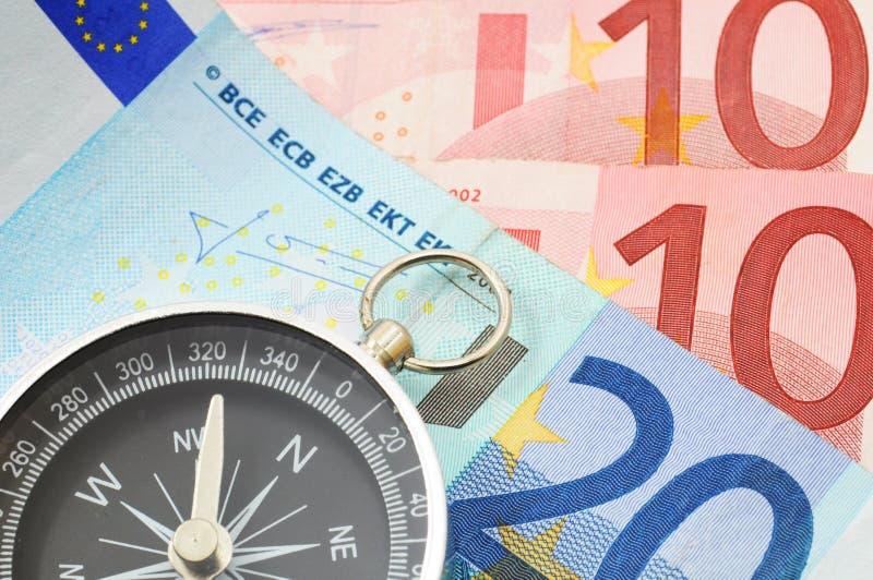 Eurogeld und Kompaß lizenzfreies stockfoto