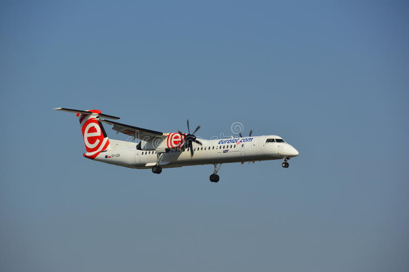 Eurolot Airline plane. This is a view of Eurolot plane landing over the Chopin Airport in Warsaw. October 6, 2014. Chopin Airport in Warsaw, Poland stock photos