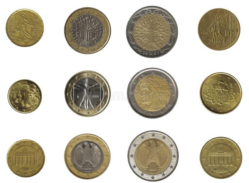 Euromünzen von drei Nationen lizenzfreie stockbilder