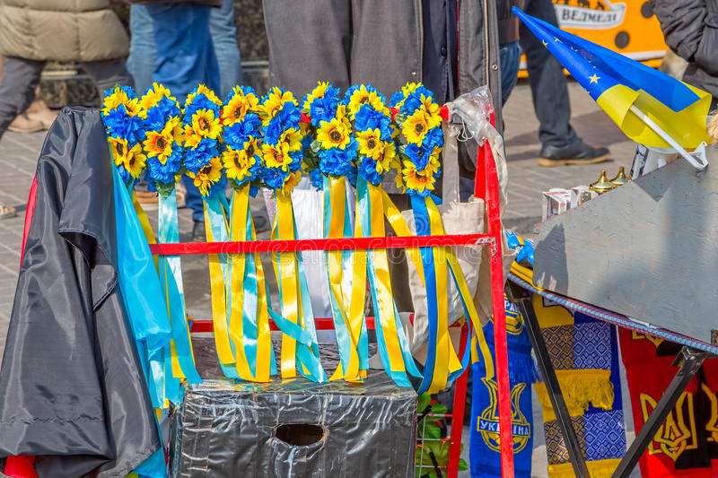 Euromaidan revolution in Kiev. KIEV, UKRAINE - MARCH 22, 2014: People selling decorative ribbon in the colors of the Ukrainian flag as the Revolution symbols royalty free stock images