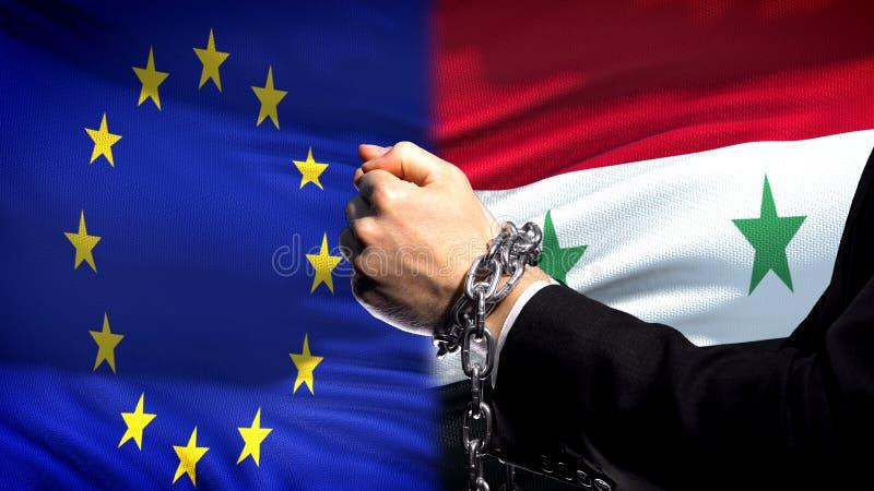 Europäische Gemeinschaft sanktioniert Syrien, verketteten Arm-, politischen oder wirtschaftlichenkonflikt lizenzfreies stockbild