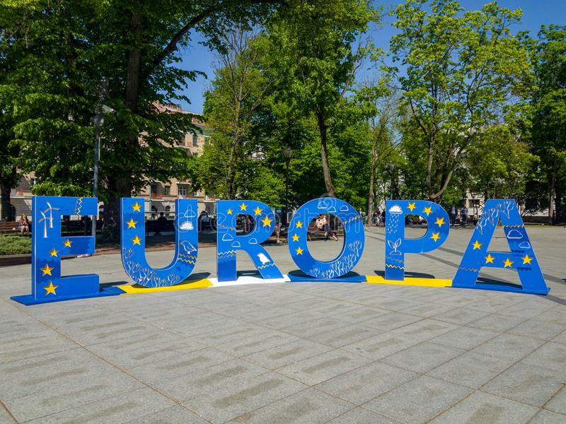 Europa in big blue letters. Big blue letters formatting sign `EUROPA` Europe in the park stock photography