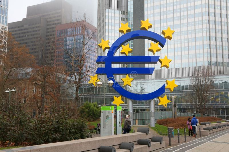 Europe Central Bank. FRANKFURT, GERMANY - DECEMBER 6, 2016: Euro currency sign in front of European Central Bank in downtown Frankfurt, Germany. ECB administers royalty free stock photo