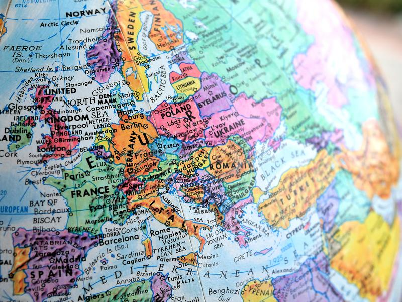 Europe focus macro shot on globe map for travel blogs, social media, website banners and backgrounds. stock photography