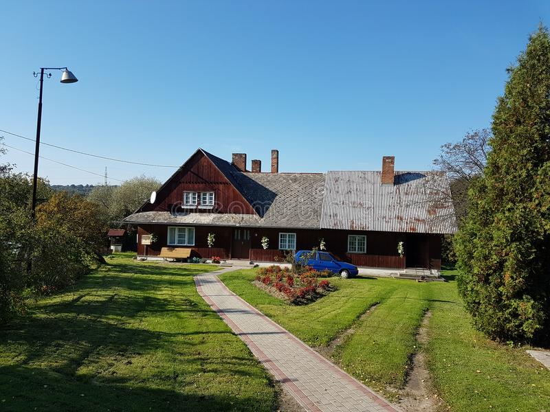 Europe. Poland country, Jaslo city. Wooden cottage house. Front yard of a village. Europe. Poland country. Jaslo city. Wooden cottage house. Front yard of a royalty free stock image