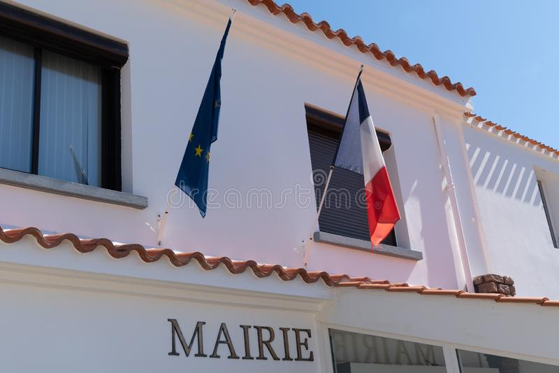 Europe Union EU and French flag on city hall in Noirmoutier Island. A Europe Union EU and French flag on city hall in Noirmoutier Island stock images