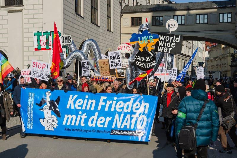 European anti-NATO peaceful protest demonstration. Munich, Germany - February 7, 2015: European anti-NATO peaceful protest demonstration. Texts on banners and stock image