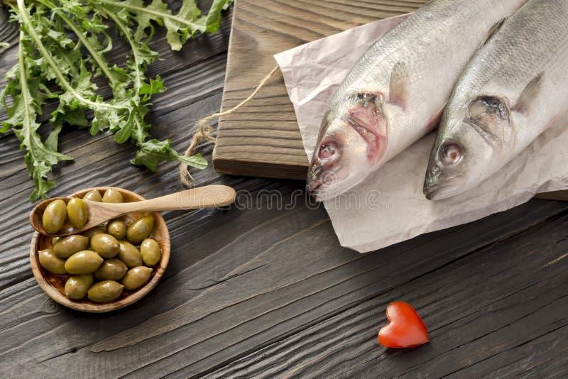 European bass Dicentrarchus labrax on a wooden table stock photos