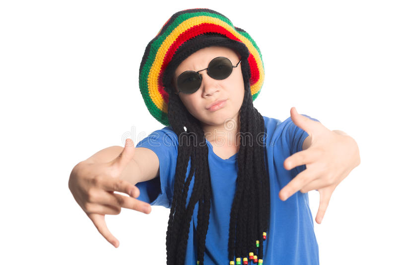 European boy in a cap with dreadlocks sings rap stock photography