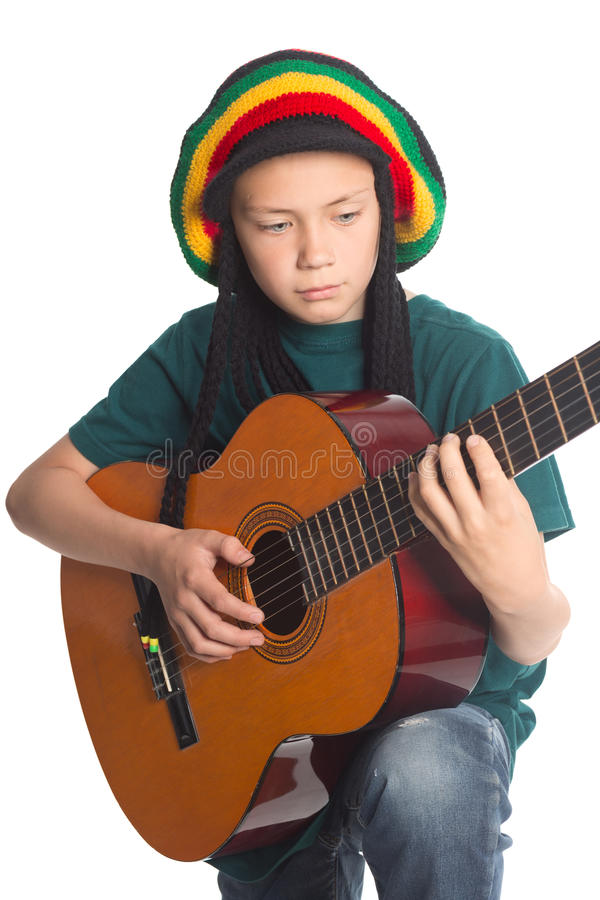 European boy with guitar and hat with dreadlocks royalty free stock photos