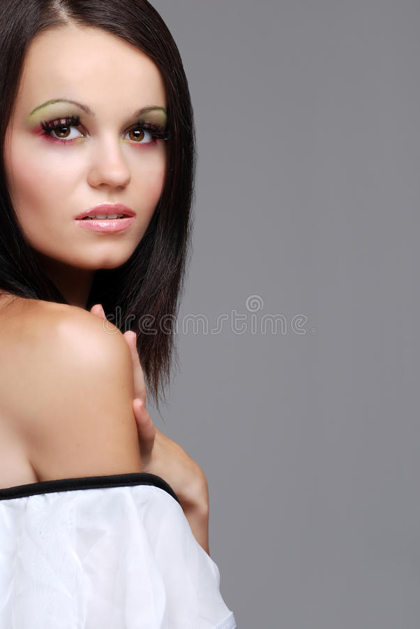 European Brunette Woman Wearing A White Top Royalty Free Stock Photos