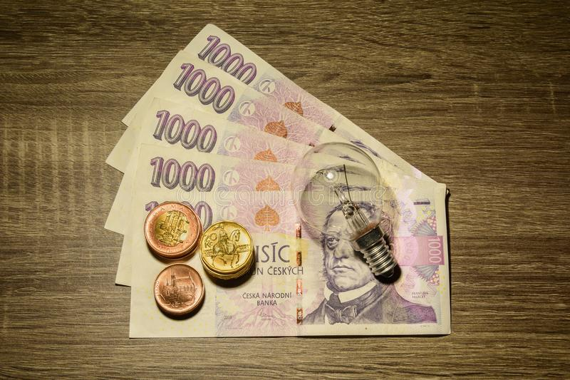 European bulb placed on Czech money stock photography
