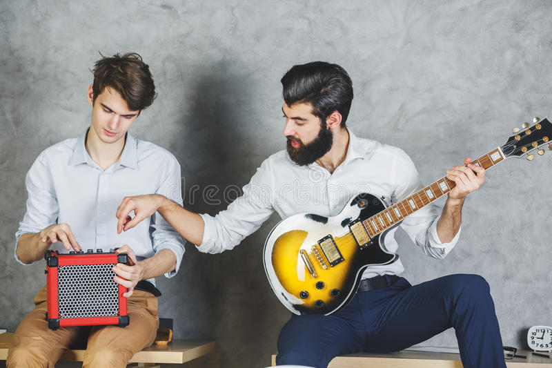 European businessmen playing with guitar stock photography