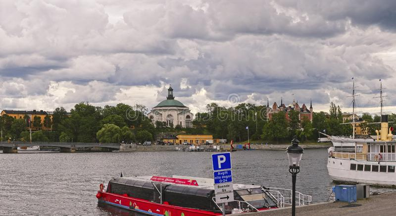 European capitals. Stockholm modern and ancient buildings. European capitals. Panoramic view of a wood on the sea with modern and ancient building in Stockholm stock photos
