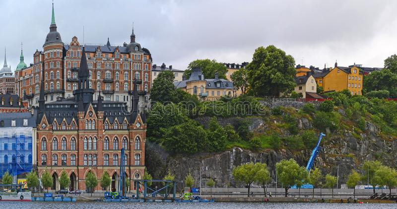 European capitals. Stockholm modern and ancient buildings. European capitals. Panoramic view of a wooded hill on the sea with modern and ancient building in stock photo