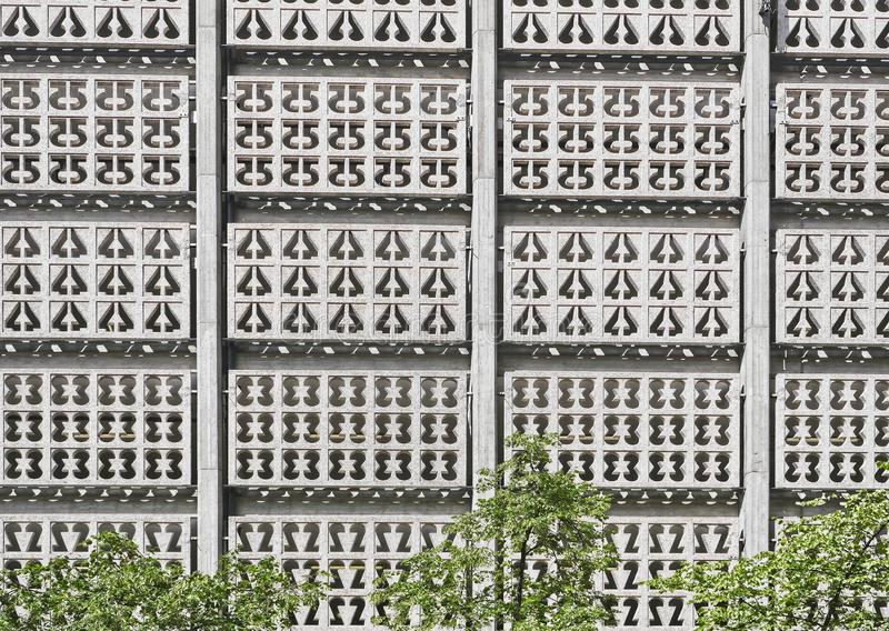 European capitals. Stockholm modern and ancient buildings. European capitals. Detail of modern building in Stockholm city. Geometric design and tree stock image