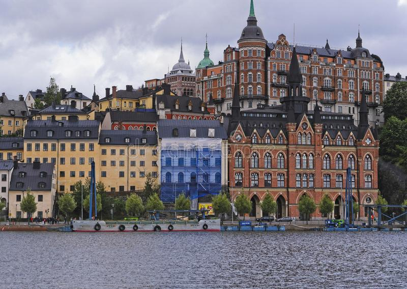 European capitals. Stockholm modern and ancient buildings. European capitals. Panoramic view of a wooded hill on the sea with modern and ancient building in royalty free stock images