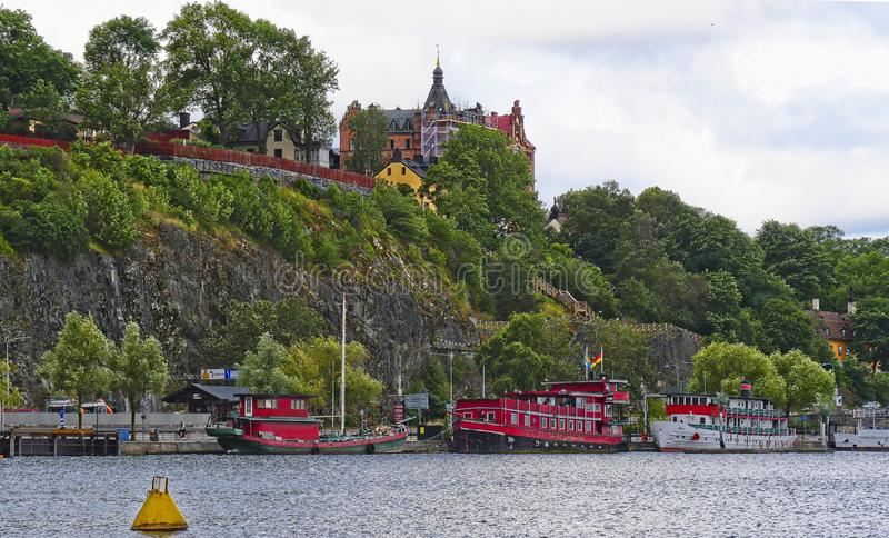 European capitals. Stockholm modern and ancient buildings. European capitals. Panoramic view of a wooded hill on the sea with modern building in Stockholm city royalty free stock photo