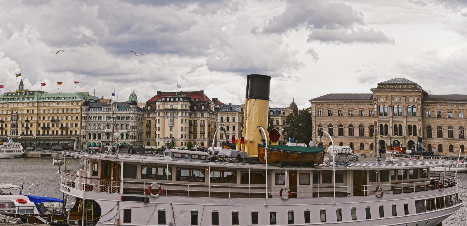 European capitals. Stockholm view with boat and buildings. European capitals. Panoramic view of a modern and ancient  on the sea building in Stockholm city royalty free stock photography