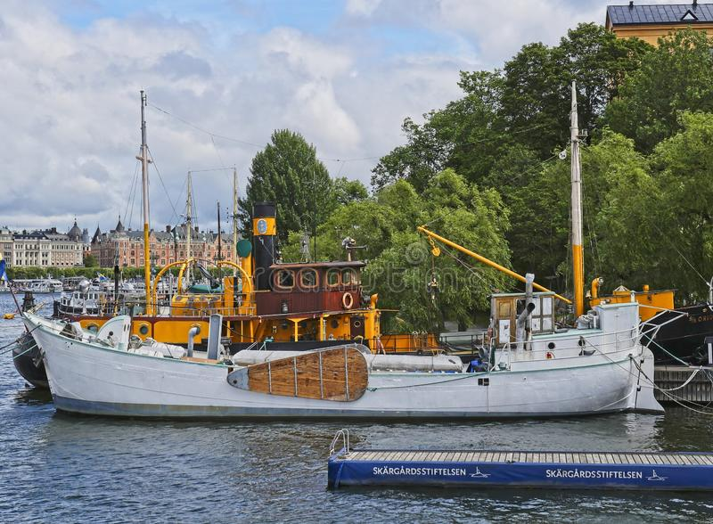European capitals. Stockholm view with boat and buildings. European capitals. Panoramic view of a modern and ancient  on the sea building in Stockholm city stock images