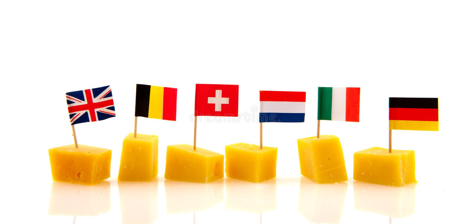 European cheese cubes. Cheese cubes from Europe with different flags stock images