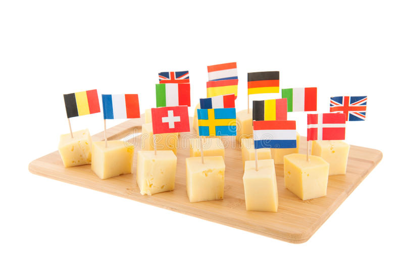 European cheese cubes. Tray with European cheese cubes with flags stock images