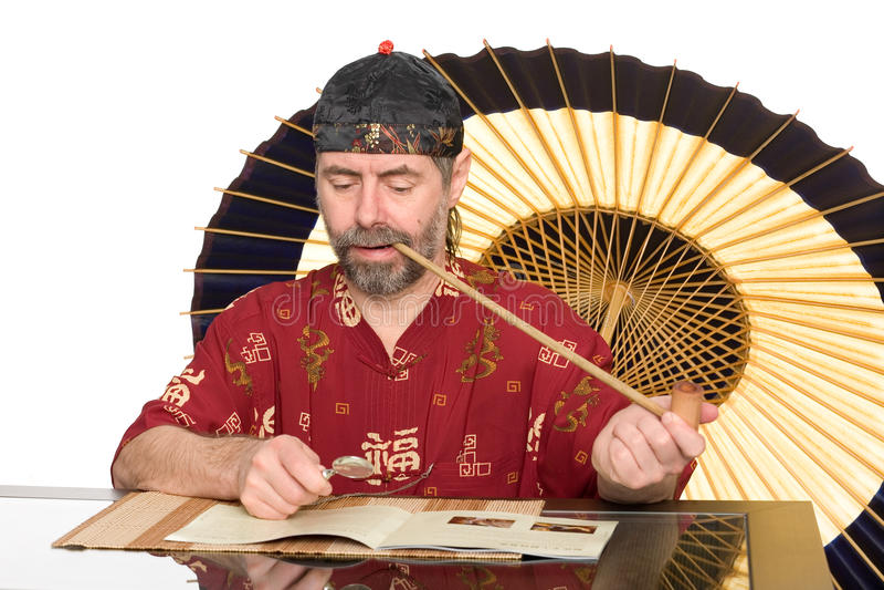 European in chinese costume smokes pipe