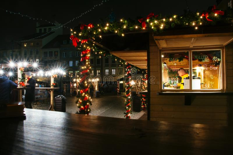 European Christmas market, food stall at night royalty free stock photos