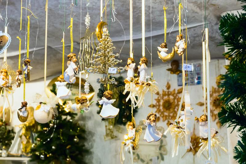 European Christmas market stall with angels gifts. Christmas market stall with angels souvenirs for sale royalty free stock image