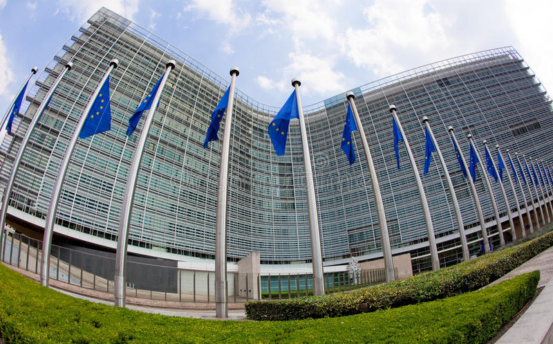 European commission. European flags in front of the Berlaymont building, headquarters of the European commission in Brussels stock photos