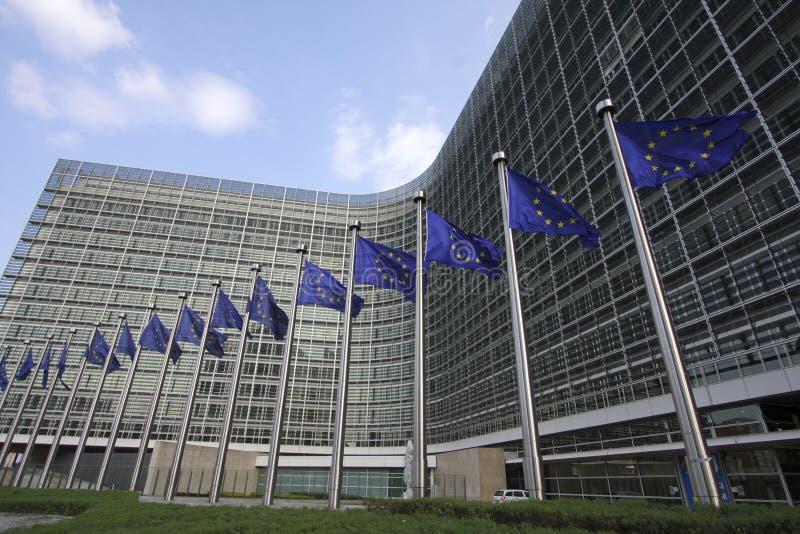 European Commission. European flags in front of the European Commission Berlaymont building in Brussels, Belgium stock photo