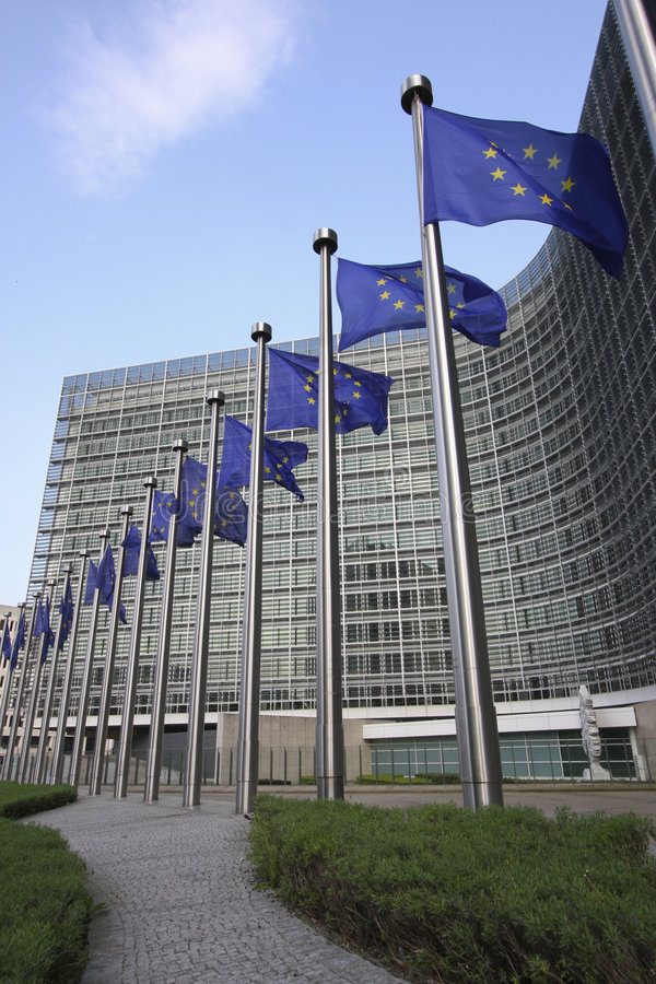 European Commission. European flags in front of the European Commission Berlaymont building in Brussels, Belgium royalty free stock photography