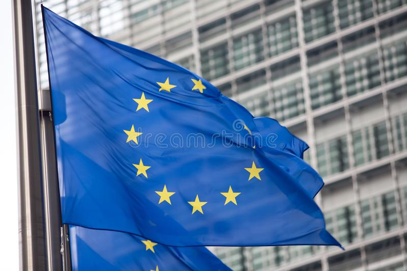 European Commission EU flag in Brussels. EU flag in front of European Commission building in Brussels royalty free stock image