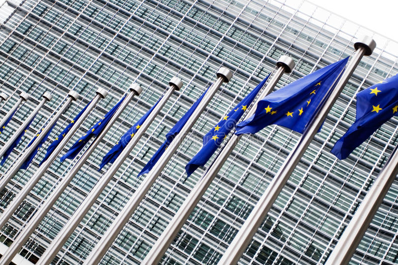 European commission with European flags. European flags in front of the European commission building in Brussels royalty free stock image