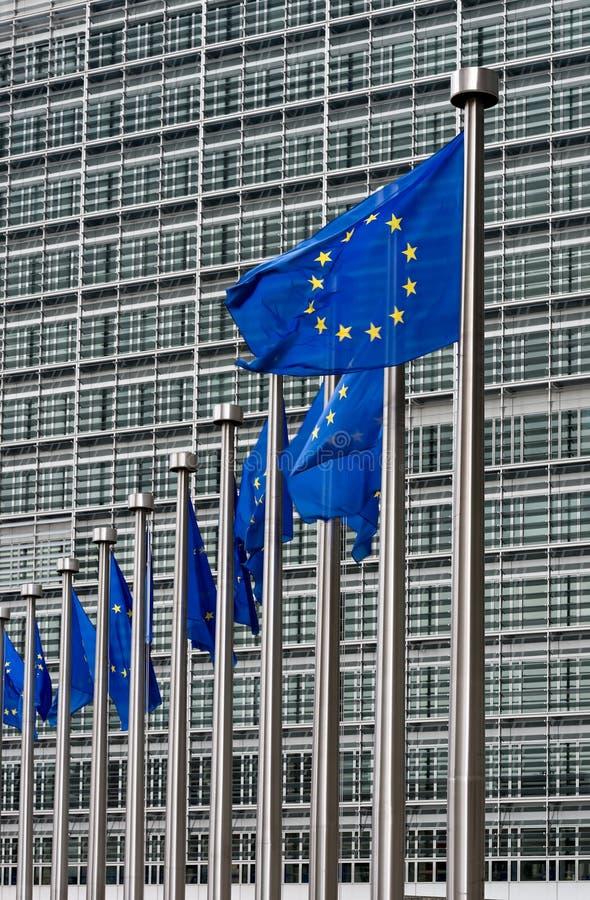 European Commission Headquarters. Waving European Union Flags in Front of European Commission Headquarters in Brussels, Belgium stock photos