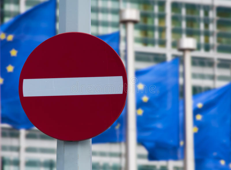 European commission sanctions against Russia concept. 'No entry' sign in front of European comission flags stock image