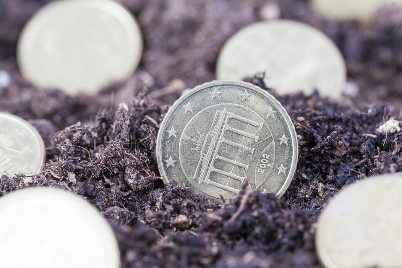 European euro cents. In coins, closeup of planting or harvesting money stock photography