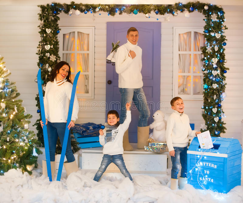 European family of four in Christmas decorations royalty free stock image