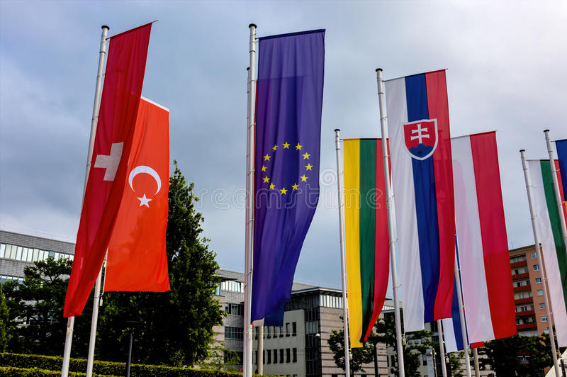 European flag and other flags. Symbolism of diplomacy and international cooperation royalty free stock photography
