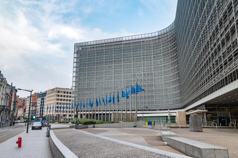 European flags in front of the European Commission headquarters in Brussels, Belgium. Brussels, Belgium - June 5, 2019: European flags in front of the European royalty free stock photography