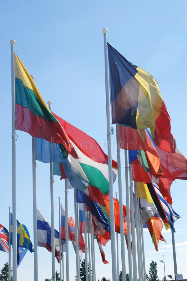 European flags in the wind. Flags of European states against blue sky stock photography
