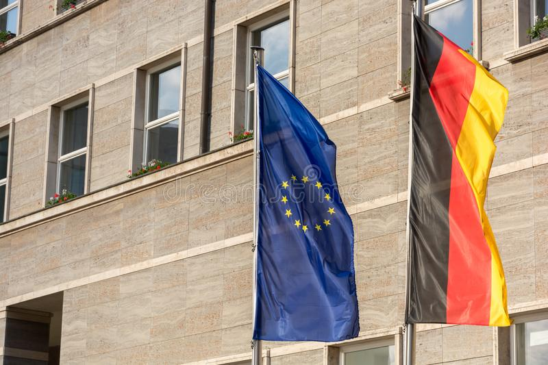 European and german flag in front of an office building stock images